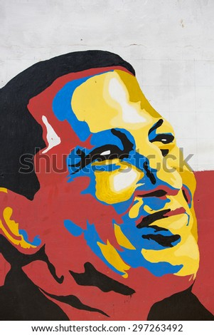 MARGARITA, VENEZUELA, APRIL 15: Colourful graffiti of head of President Hugo Chavez in the wall of Pampatar. Venezuela - stock photo