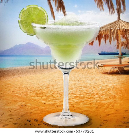 Margaritas with lime background of beach - stock photo