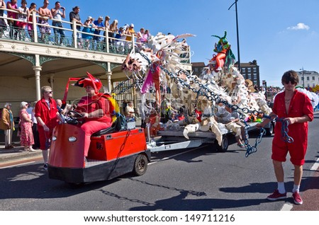 MARGATE, UK-AUGUST 4: Ant costumed performers and dragon float,part of Great British Carnival group,entertain the crowds at Margate's annual carnival. August 4, 2013 in Margate, UK - stock photo