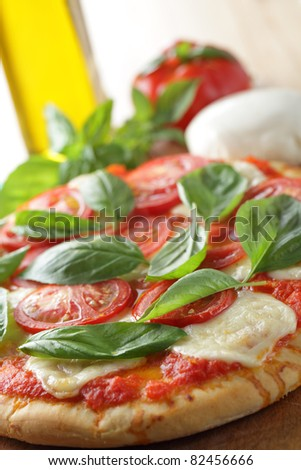 Margherita pizza with mozzarella, tomato, and basil - stock photo