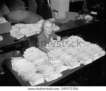 Marguerite 'Missy' Lehand, FDR's secretary opening March of Dimes mail. Jan. 28, 1938 - stock photo