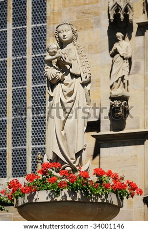 Maria and Child Jesus sculpture standing in front of cathedral in Erfurt, Germany.