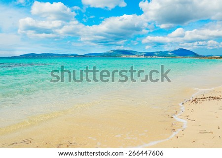 Maria Pia beach on a cloudy spring day. Shot in Alghero, Italy - stock photo