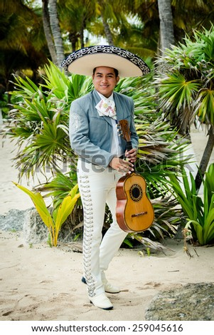 Mariachi singer playing a guitar in Mexico  - stock photo
