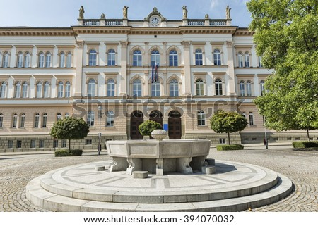 Maribor secondary school building facade in Slovenia. The building of the school was planned by Graz based architect Wilhelm Bucherja and built in 1873 in classical style. - stock photo