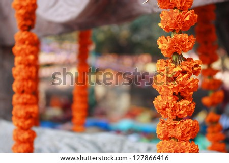 Marigold garland at Mahabodhi Buddhist temple Bodhgaya India - stock photo