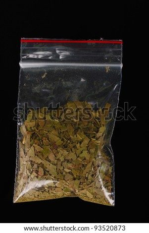marihuana in package on black background - stock photo