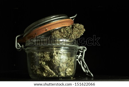 Marijuana and Cannabis, Jar of Weed on Black Background  - stock photo