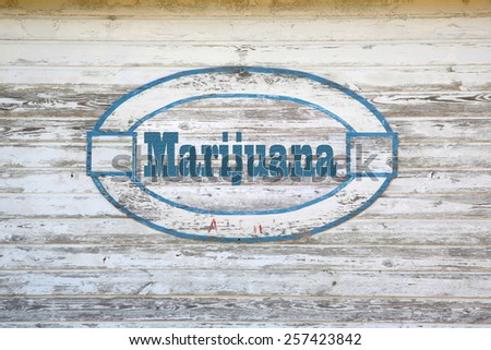 Marijuana Concept -  marijuana road sign on shed side - stock photo