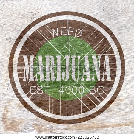 marijuana sign with wood grain texture - stock photo