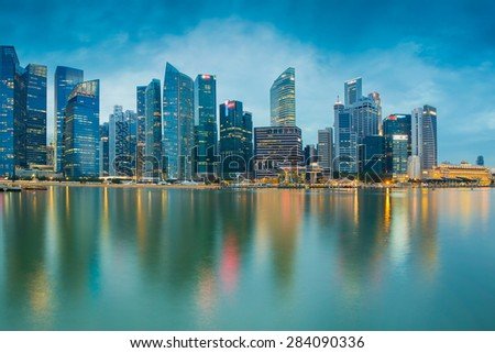 Marina bay business office during twilight with water reflection, Singapore