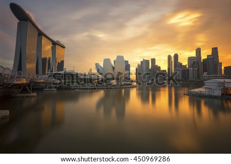 MARINA BAY, SINGAPORE -  JULY 9. Singapore skyline, Singapore Marina bay at dusk. Marina Bay is a bay located in the Central Area of Singapore in 9 JULY 2013.