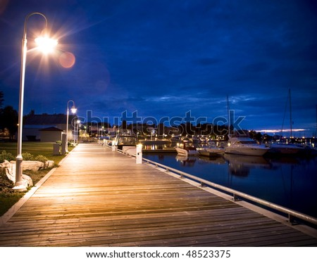 Marina Boardwalk At Dusk - stock photo
