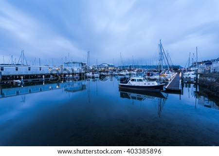 Marina with sail boats at twilight in Plymouth UK. City popular waterfront. - stock photo