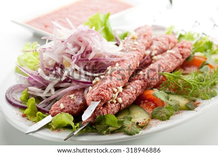 Marinated Beef Kebab with Onions and Herbs. Uncooked Meat - stock photo