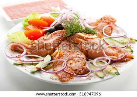 Marinated Chicken Breast with Onions and Vegetables - stock photo
