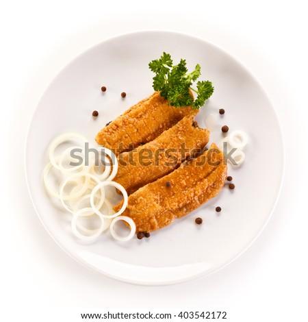 Marinated fried herring fillets on white background  - stock photo