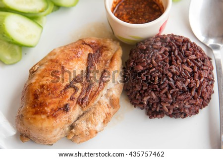 Marinated grilled healthy chicken breasts cooked serve with thai sauce and Riceberry Rice - stock photo