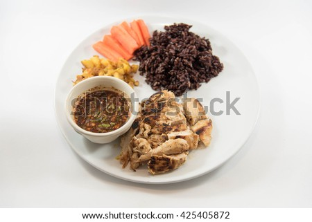 Marinated grilled healthy chicken breasts cooked  serve with thai spicy sauce and riceberry rice,Thai style food - stock photo