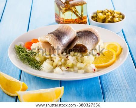 Marinated herring fillets  - stock photo