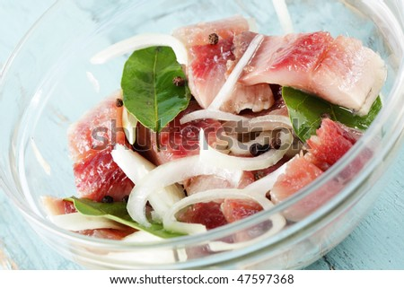 Marinated herring with onion and bay leaf