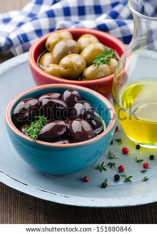 Marinated olives in small bowls  - stock photo