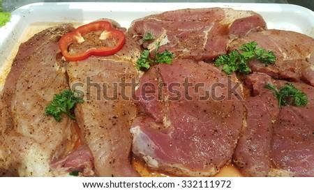 marinated raw  pork steak - stock photo