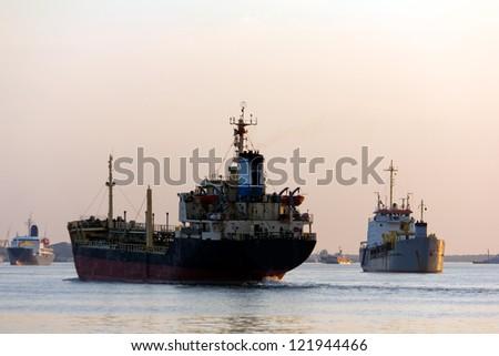 Marine and Cargo Hull at sunset period - stock photo