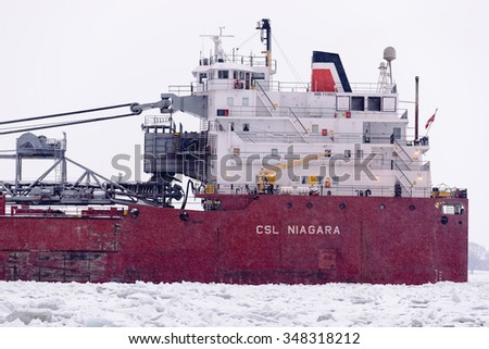 MARINE CITY, MI, USA /JANUARY 21, 2015: The CSL NIAGRA of the Canada Steamship Lines is up bound on the icy St Clair River at Marine City, MI on January 21, 2015.