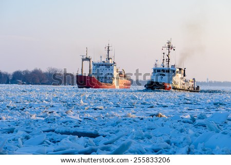 MARINE CITY, MI - USA - JANUARY 23, 2015: The USCG BRISTOL BAY on January 23, 2015 working ice on the St Clair River at MARINE CITY, MI. The CCGS GRIFFON is also working the heavy ice.