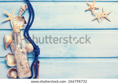 Marine items on blue painted wooden background.  Toned image. Place for text.  Selective focus. - stock photo