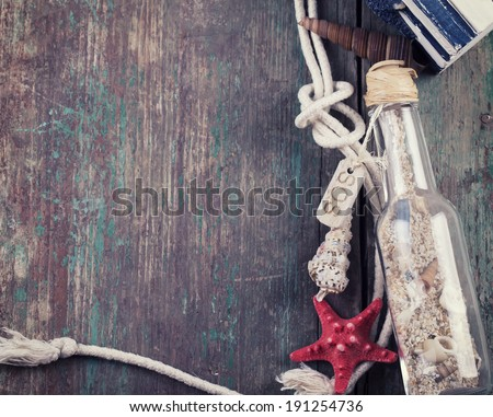 Marine items on wooden background. Sea objects on aged wooden planks. Selective focus. Top view. - stock photo