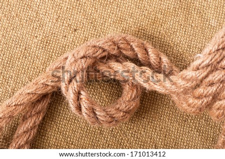 marine knot on background of the old fabric