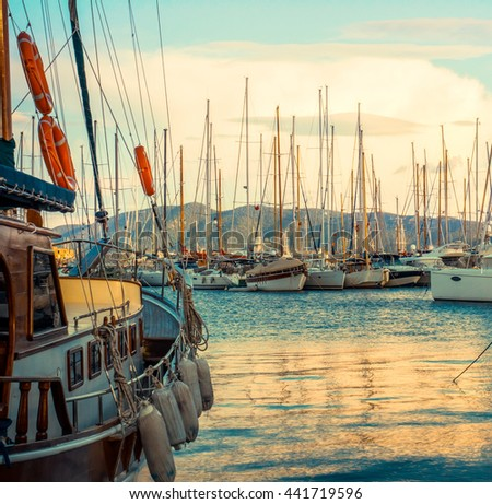 Marine landscape with yachts in a Bodrum marina. Seascape with many sailboats in yacht club at sunset. Yachting and luxury leisure at Aegean Sea, Turkish Riviera.  - stock photo