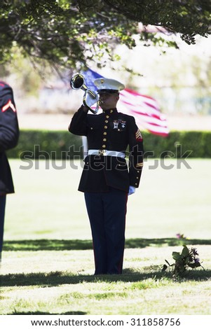 """Marine playing taps at Memorial Service for fallen US Soldier, PFC Zach Suarez, """"Honor Mission"""" on Highway 23, drive to Memorial Service, Westlake Village, California, USA, 06.19.2014 - stock photo"""