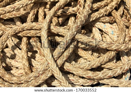 Marine rope as  for a boat or yacht in a tangled and twisted position - stock photo