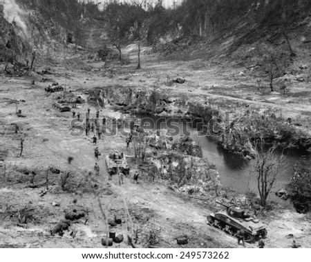 Marine tanks and infantry assault Japanese positions in a Peleliu Island ridge, Oct. 7, 1844. World War 2, Pacific Ocean. - stock photo