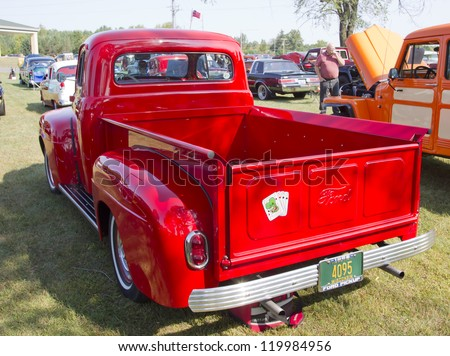 MARION, WI - SEPTEMBER 16: Back of 1952 Red Ford Pickup Truck at the 3rd Annual Not Just Another Car Show on September 16, 2012 in Marion, Wisconsin. - stock photo