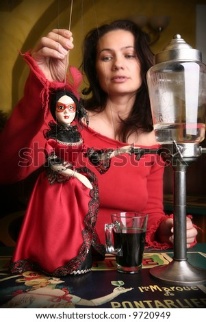 Marionette and absinthe - stock photo