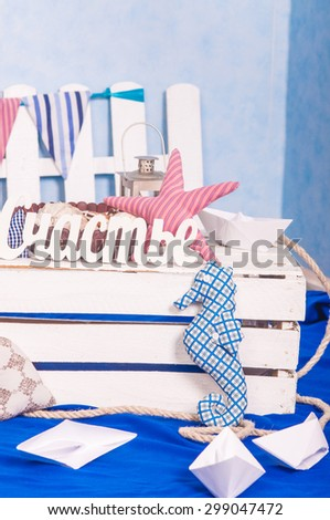 Maritime decor paper boats, shells and toys