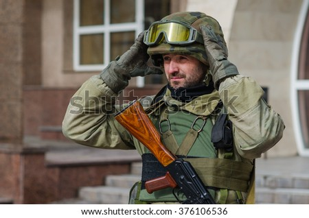 MARIUPOL, UKRAINE - FEBRUARY 12, 2016. Ukrainian soldier at the centre of the Mariupol city.