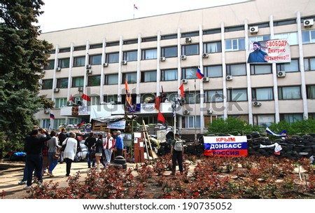 MARIUPOL, UKRAINE - MAY 4, 2014: Supporters of federalization of Ukraine at the City Council building, blocked by barricades.