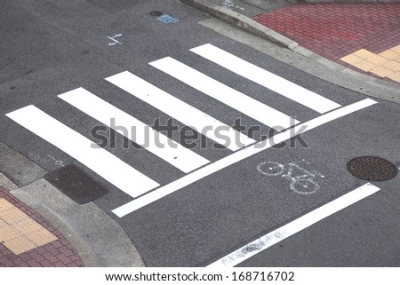 Mark of a bicycle zone and Pedestrian crossing, Japan - stock photo