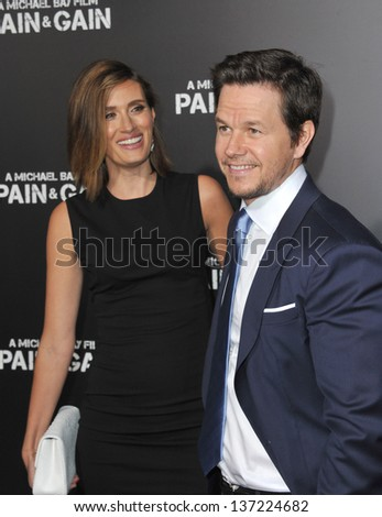 """Mark Wahlberg & wife Rhea Durham at the Los Angeles premiere of his movie """"Pain & Gain"""" at the Chinese Theatre, Hollywood. April 22, 2013  Los Angeles, CA  - stock photo"""