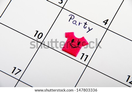 Marked date for a party on a calendar. - stock photo
