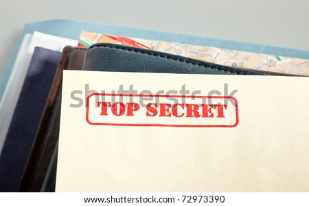 "marked ""top secret"" on a pile of documents - stock photo"