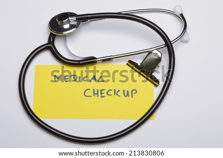marker with the text medical checkup next  to a stethoscope - stock photo