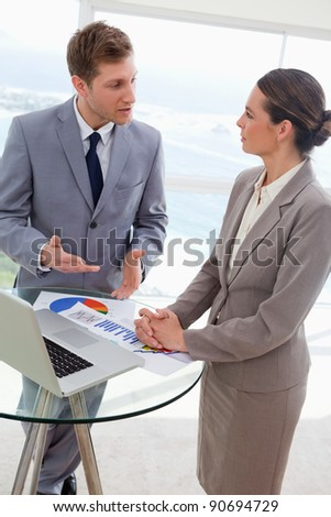 Market analysts talking about research results - stock photo