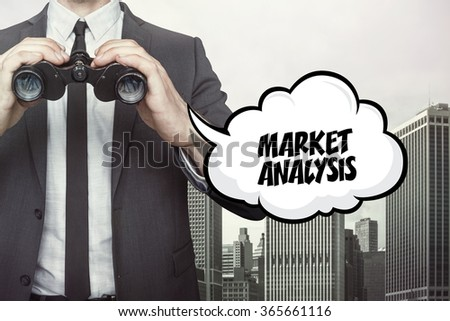 Market analytics text on speech bubble with businessman holding binoculars - stock photo