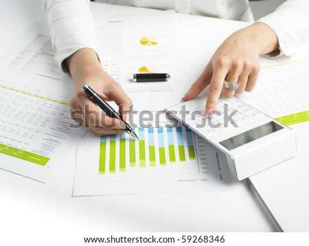 Market Analyze - pen and calculator on papers - stock photo